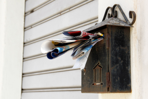 piled up mail in your mail box