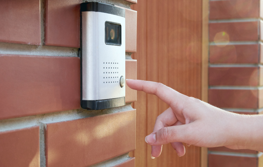 Person ringing the door bell camera